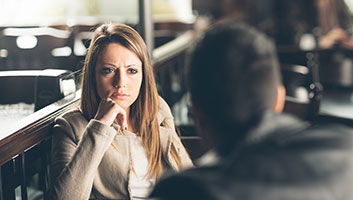 Woman bored after conversation with man